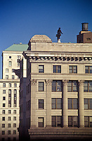 architectural design Philadelphia PA William Penn statue atop City Hall behind office buildings