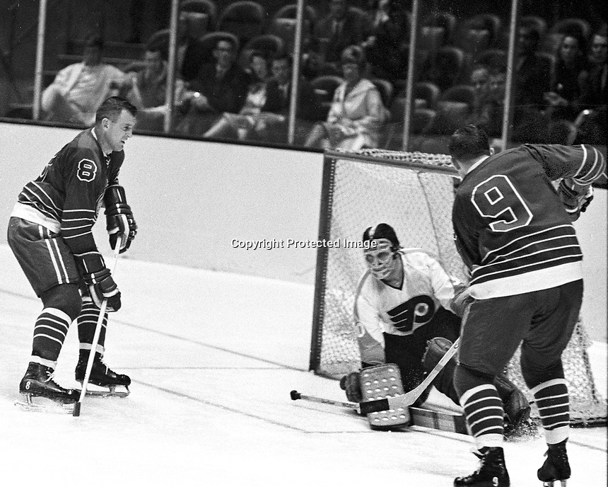 Seals vs Flyers 1967, Seals Gerry Ehman and Bill Hicke try to score on goalie Bernie Parent..Ron Riesterer/photo