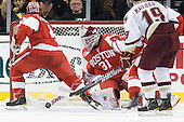 Adam Clendening (BU - 4), Kieran Millan (BU - 31) - The Boston College Eagles defeated the Boston University Terriers 3-2 (OT) in their Beanpot opener on Monday, February 7, 2011, at TD Garden in Boston, Massachusetts.
