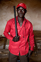 A member of a Muslim 'self-defence' group holds a wooden baton. In late 2012 after years of instability and conflict, the Seleka, a predominantly Muslim rebel group, fuelled by grievances against the government, overran the country and, In March 2013, ousted President Francois Bozize, who fled the country. The rebel's leader Michel Djotodia was proclaimed president in August 2013. He disbanded the Seleka in September 2013 but law and order collapsed and ex-Seleka fighters roamed the country committing atrocities against the civilian population. In an attempt to defend their lives and property vigilante groups, calling themselves Anti-Balaka (Anti-Machete), formed to confront the ex-Seleka fighters but soon began to take reprisals against the wider Muslim population and the conflict became increasingly sectarian. By December 2013, with international fears of a genocide being voiced, French led peacekeepers deployed to the country began to act on a UN mandate to disarm the fighters and protect the civilian population. However, they have struggled to contain the situation. Much of the Muslim population, in particular, have been forced into ghettos where they are suffering from food shortages and limited access to healthcare. Often, only a few peacekeepers stand between them and a massacre by vengeful Anti-Balaka militants. UN reports describe 'thousands' killed, while over 600,000 people have been internally displaced and a further 200,000 have fled the county.