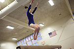 A member of the Los Altos High School gymnastics team performs her beam routine.