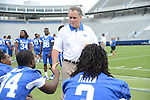 Rick Minter, Defensive Coordinator, talks to some players at UK Football Media Day on Friday, August 3, 2012. Photo by Mike Weaver| Staff