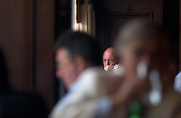 The face of a local man hints at the ghost of noted Argentine author Jorge Luis Borges as he sips coffee at the Cafe Petit Colon in Buenos Aires. Borges, a magic realist author, influenced the work of many of the western hemisphere's greatest writers.<br />