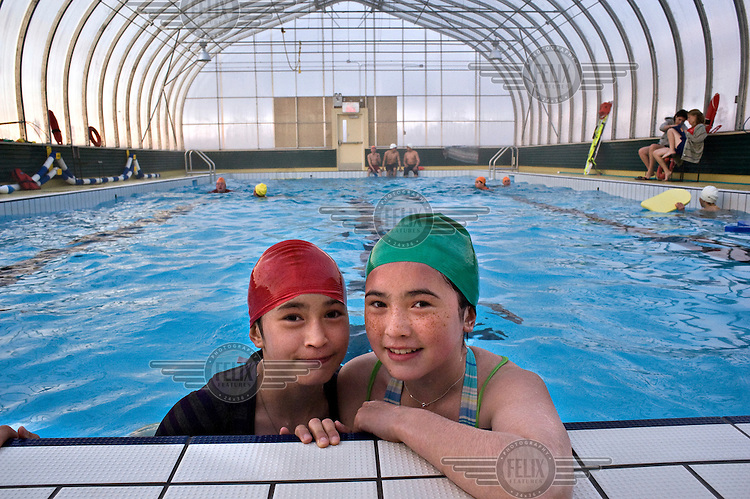 Two Inuit girls in Kuujjuaq's municipal swimming pool. The swimming pool is open in the summer months between June and September. .