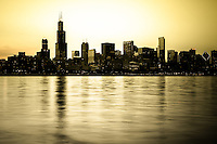 Photo of Chicago skyline at sunset with many popular downtown Chicago Loop buildings including Willis Tower Sears Tower) one of the tallest skyscrapers in the world. Image is toned, high resolution and was taken in October 2011. Picture is available as a stock photo, poster or print.