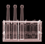 X-ray image of a short factory (red on black) by Jim Wehtje, specialist in x-ray art and design images.