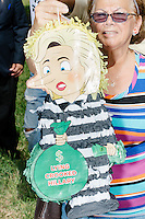 "With a small group of pro-Trump protesters, Adalila Schneider, 74, of Miami Spring, Floriad, holds a pinata of Hillary Clinton reading ""Lying Crooked Hillary"" before a campaign rally for Democratic presidential nominee Hillary Clinton in the Theodore R. Gibson Health Center at Miami Dade College-Kendall Campus in Miami, Florida, USA. The protesters shouted hateful language to people lined up to enter the rally. Schneider said she is a Trump supporter because ""I believe in him. He will protect our nation. [Hillary] is a liar. She don't protect Benghazi. She is cornuda!"" Asked what she meant by ""cornuda,"" which is Spanish for ""horned,"" she explained that it's used for people whose husband or wife have cheated on them, similar to the English word ""cuckold."" Originally from Nicaragua, Schneider has been an American citizen for 40 years and says she has always voted Republican."