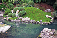 Ninomaru garden was designed by the famous landscape architect and tea master, Kobori Enshu. It is located between the two main rings of fortifications, next to the palace of the same name. The garden has a large pond with three islands and features numerous carefully placed stones and topiary pine trees.  Nijo Castle and its garden are a UNESCO World Heritage site.