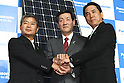 May 31, 2010 - Tokyo, Japan - General manager of Sanyo's solar division Tetsuhiro Maeda (L), Panasonic Executive Vice President Toshihiro Sakamoto and Managing Director and Chief Director of House Building Marketing in Panasonic  Electric Works Co. Masahiro Ido pose for the picture during a press-conference in Tokyo, on May 31, 2010. The Panasonic Group will launch on July 1, 2010 its HIT215 Series household solar power generation systems, the first series since he acquired domestic rival Sanyo Panasonic is aiming for top market share of at least 35 percent in Japan by 2012.
