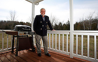 NWA Democrat-Gazette/DAVID GOTTSCHALK - 3/17/15 - Larry Shaffer stands in his favorite personal space, the back deck of his home on Black Oak Road, Tuesday March 17, 2015.