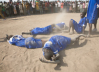 The young women of the Akoc Thon team celebrate after winning a volleyball match at the Twic Olympics in Wunrok, Southern Sudan.