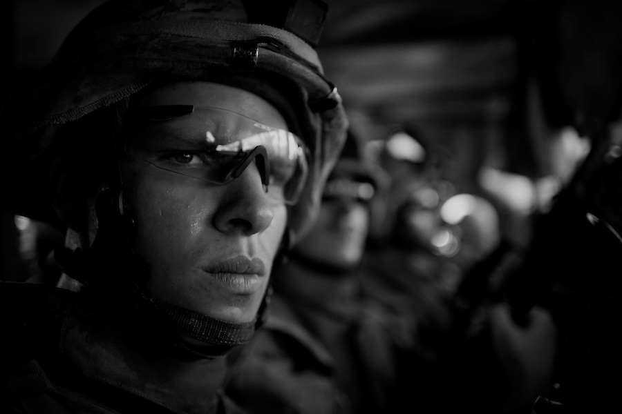 Marines from Alpha Co. 1st Battalion 6th Marines ride warily through the streets of Ramadi, Iraq on Fri. Oct. 13, 2006..