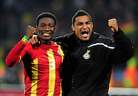 Asamoah Gyan of Ghana celebrates at the final whistle with Kevin Prince Boateng. Ghana defeated the USA 2-1 in overtime in the 2010 FIFA World Cup at Royal Bafokeng Stadium in Rustenburg, South Africa on June 26, 2010.