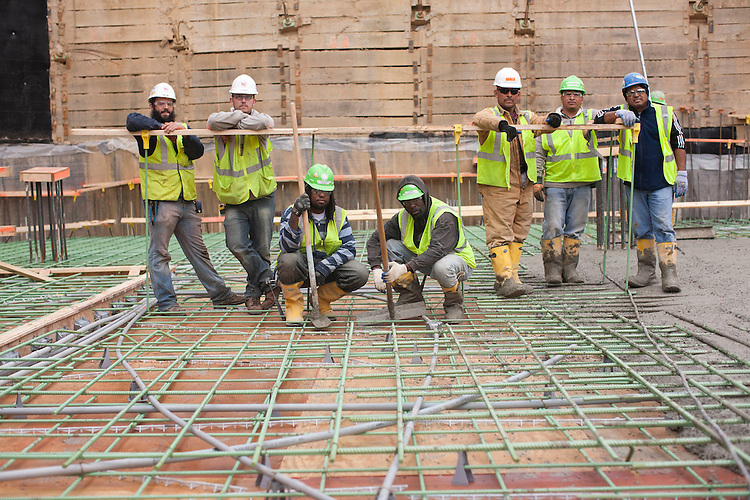©2012 David Burnett/.Contact Press Images.Washington DC.November 19 2012..construction workers at the Louis / 14th st construction project (14th & U st Washington DC)   by JBG.