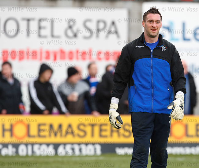 Allan McGregor warms up in front of holemasters advert