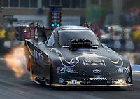 Jul. 18, 2014; Morrison, CO, USA; NHRA funny car driver Alexis DeJoria during qualifying for the Mile High Nationals at Bandimere Speedway. Mandatory Credit: Mark J. Rebilas-