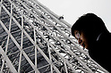 May 22, 2011, Tokyo, Japan - A man looks up Tokyo Sky Tree. Tokyo Skytree, the world's tallest self-standing telecommunications tower with a height of 634 meters, opens today. This new Japanese landmark is expected to attract approximately 200,000 visitors on this first official opening day to the general public. (Photo by Yumeto Yamazaki/Nippon News)