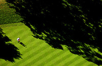 "Tiger Woods and caddie Steve Williams in the fourteenth fairway at Medinah CC during the final round of the 2006 PGA Championship. Photographed from the MetLife Blimp ""Snoopy One."" Photograph © 2006 Darren Carroll."