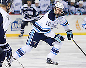 Brian Flynn (Maine - 10) - The University of Maine Black Bears defeated the University of New Hampshire Wildcats 5-4 in overtime on Saturday, January 7, 2012, at Fenway Park in Boston, Massachusetts.