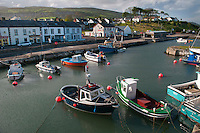 Carnlough, Northern Ireland, United Kingdom, May 2011. Fishing boats in Carnlough Harbour. Carnlough is a village in County Antrim, Northern Ireland. It has a picturesque harbour on the shores of Carnlough Bay. Carnlough is situated on the Coast Road beside the North Channel and at the foot of Glencloy, the second of the nine Glens of Antrim. For decades travellers stayed away from the sectarian violence, but since the end of'The Troubles' more and more people start discoving the beauty of Belfast and the Antrim Coast Causeway. Photo by Frits Meyst/Adventure4ever.com