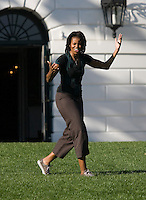 Michelle Obama reacts to missing a shot on goal during a Lets Move! soccer clinic held on the South Lawn of the White House.  Let's Move! was started by Mrs. Obama as a way to promote a healthier lifestyle in children across the country.