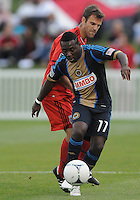 Philadelphia Union midfielder Freddy Adu (11) shields the ball against D.C. United defender Daniel Woolard (21) The Philadelphia Union defeated D.C. United 2-1in extra time at the round of sixteen of the Lamar Hunt U.S. Open Cup at The Maryland SoccerPlex, Tuesday June 6, 2012.