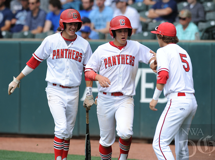 NWA Democrat-Gazette/ANDY SHUPE<br /> Cabot's Bobby Duncan (center) is congratulated by Dillon Thomas (5) Friday, May 19, 2017, after scoring on a passed ball during the Class 7A state championship game at Baum Stadium in Fayetteville. Visit nwadg.com/photos to see more photographs from the game.
