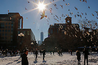 People enjoy a sunny day in Washington Square Park  while the One World Trade Center is seen in the background after the pass of the winter storm JONAS, in New York, 01/24/2016. Photo by VIEWpress