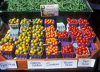 Farm Stand Display of cherry tomato types including heirloom varieties Red Pear, Green Grape, Sungold, Yellow Pear, Red Plum in cartons
