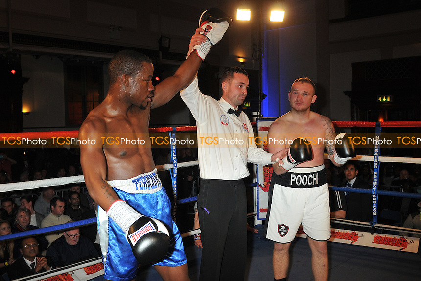 Daryll Williams (blue shorts) defeats Lewis van Poetsch - Boxing at the Camden Centre, London - 21/11/14 - MANDATORY CREDIT: Philip Sharkey/TGSPHOTO - Self billing applies where appropriate - contact@tgsphoto.co.uk - NO UNPAID USE