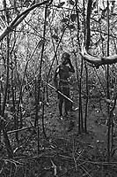 Child labor in the mangrove thicket, crab hunter. City: Maragogipe; State: Bahia, Brazil.