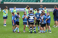 """Bath Rugby players take part in a coaching session with children from Twickenham Academy and Bournemouth Collegiate School. Bath Rugby Photocall for """"The Clash"""" on September 22, 2016 at Twickenham Stadium in London, England. Photo by: Andrew Fosker / Onside Images"""