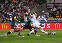 Steven Gerrard (4) of England scores the opening goal. USA vs England in the 2010 FIFA World Cup in Rustenburg, South Africa on June 12, 2010.