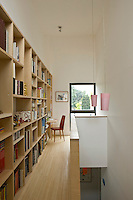 A long custom-made bookcase, with plenty of room for a large collection, runs the length of the library which is situated on the landing at the top of the stairs