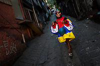 A Brazilian boy, wearing a spooky costume, takes part in the Carnival parade in the favela of Rocinha, Rio de Janeiro, Brazil, 20 February 2012. Rocinha, the largest shanty town in Brazil and one of the most developed in Latin America, has its own samba school called GRES Academicos da Rocinha. The Rocinha samba school is very loyal to its neighborhood. Throughout the year, the entire community actively participate in rehearsals, culture events and parades related to the carnival.
