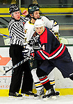 29 December 2010: University of Vermont Catamounts forward H.T. Lenz, a Freshman from Vienna, VA, is checked into an official by Dan Lassik, a defenseman attending University of Rhode Island playing for the 2011 U.S. Men's National University Team in an exhibition game at Gutterson Fieldhouse in Burlington, Vermont. The Catamounts defeated the National team 7-1. Mandatory Credit: Ed Wolfstein Photo