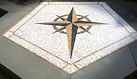 Custom Compass medallion, a stone hand cut mosaic, shown in honed Giallo Reale, Nero Marquina, Calacatta Tia, Verde Luna, and Jura Green.