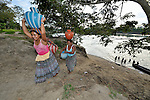 Women carry home water in the Guatemalan village of Santa Elena, located in the Peten region along the Salinas River where it forms a border with Mexico.