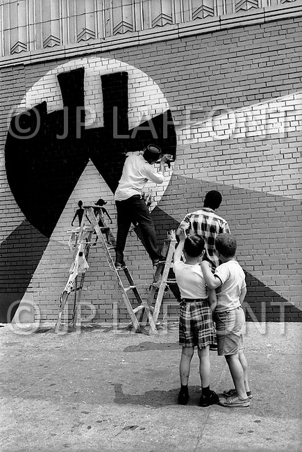 Bronx, New York City, NY - Summer of 1966 <br /> On Fox Street in the Bronx street artists working on a store outside wall.
