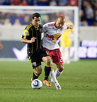 Dilly Duka (11) of the Columbus Crew fights for the ball with Joel Lindpere (20) of the New York Red Bulls during the game at Red Bull Arena in Harrison, NJ.  The New York Red Bulls tied the Columbus Crew, 1-1.