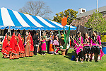 May 5, 2013 - Hempstead, New York, U.S. - By a very tall wooden tulip, Indian female dancers are ready to share the rich heritage of India in dance, at the 30th Annual Dutch Festival celebrating Hofsta University's Global Campus. The performers wear traditional makeup, gold jewelry, and colorful silk costumes, and will perform on stage in the big tent.