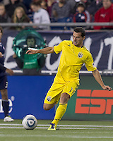 Columbus Crew midfielder Dilly Duka (11) passes the ball.  In a Major League Soccer (MLS) match, the Columbus Crew defeated the New England Revolution, 3-0, at Gillette Stadium on October 15, 2011.