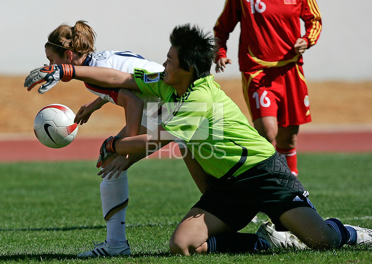 USA´s Heather O´Reilly fights for the ball with China´s Yanru Zhang during their Algarve Women´s Soccer Cup 2008 qualifying match at Albufeira Stadium in Albufeira, Algarve. March 05, 2008. Paulo Cordeiro/isiphotos.com