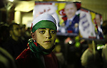 Palestinian supporters of Hamas movement hold placards and turkish flags during a rally to celebrate the the victory of Turkey's Prime Minister Recep Tayyip Erdogan in the local turkish elections, in the northern Gaza Strip, March 31, 2014. Photo by Ashraf Amra