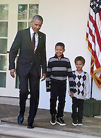 United States President Barack Obama, left, joined by nephews Austin Robinson, 6, center, and Aaron   Robinson, 4, right, arrives in the Rose Garden to pardon the 2016 National Thanksgiving Turkey, Tater, and its alternate Tot, during a ceremony at the White House in Washington, DC on Wednesday, November 23, 2016.  This is the 69th anniversary of this honored tradition began in 1947 by President Harry S Truman.  Once pardoned the birds will be sent to their new home at Virginia Tech&rsquo;s Animal and Poultry Sciences Department at &ldquo;Gobbler's Rest&rdquo; in Blacksburg, Virginia where they will be cared for by students and veterinarians.<br /> Credit: Ron Sachs / CNP /MediaPunch