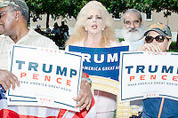 "Clara Roteta, 62, (blond) joined a small group of pro-Trump protesters gathered outside a campaign rally for Democratic presidential nominee Hillary Clinton in the Theodore R. Gibson Health Center at Miami Dade College-Kendall Campus in Miami, Florida, USA. The protesters shouted hateful language to people lined up to enter the rally. Originally from Cuba, Roteta has been in the US for 56 years. She is a Trump supporter. Roteta said of Trump, ""He's a leader. He loves his country. He will create jobs."""