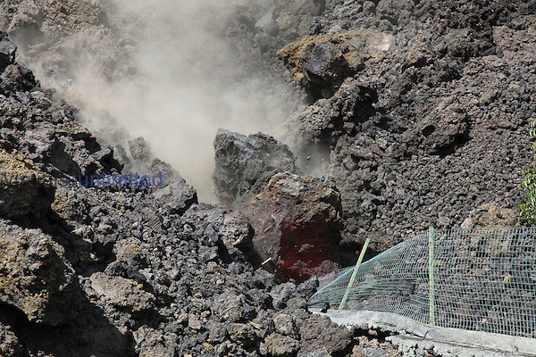 Glowing boulder falling off massive Aa lava flow from Fogo Volcano, Portela, Cape Verde