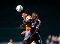 Giles Barnes (23) of the Houston Dynamo goes up for a header with James Riley (2) of D.C. United during a Major League Soccer game at RFK Stadium in Washington, DC. D.C. United vs. Houston Dynamo, 2-1.