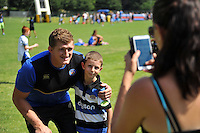 Stuart Hooper of Bath Rugby poses for a photo with a young supporter. Bath Rugby Family Festival of Rugby, on August 8, 2015 at the Recreation Ground in Bath, England. Photo by: Patrick Khachfe / Onside Images