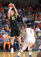 Dec. 17, 2010; Charlottesville, VA, USA; Oregon Ducks forward E.J. Singler (25) shoots the ball over Virginia Cavaliers guard Jontel Evans (1) during the first half of the game at the John Paul Jones Arena. Mandatory Credit: Andrew Shurtleff